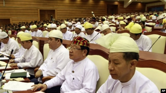 Lower House lawmakers attend a regular session of parliament in Naypyitaw, Burma, April 23, 2012.
