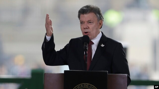 FILE - In this photo taken Nov. 6, 2015, Colombia's President Juan Manuel Santos speaks at the rebuilt Palace of Justice in Bogota, Colombia.