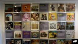 Record covers of albums U.S. musician Jimi Hendrix owned or made are displayed in exhibition space at his former central London flat, at 23 Brook Street, Feb. 8, 2016.