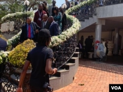 People at the Blue Roof in Harare