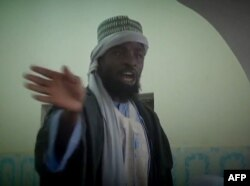 FILE - Photo made from Boko Haram video released by the Nigerian Islamist extremist group Boko Haram and obtained by AFP shows the leader of the Nigerian Islamist extremist group Boko Haram, Abubakar Shekau preaching to locals in an unidentified town.