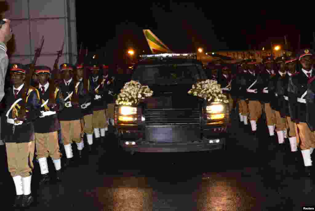 The body of Ethiopia's Prime Minister Meles Zenawi is escorted upon arrival in Ethiopia's capital Addis Ababa early August 22, 2012.