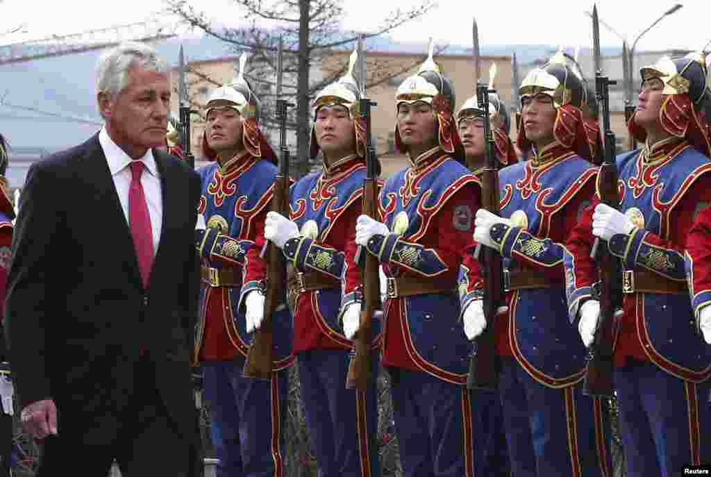 U.S. Secretary of Defense Chuck Hagel reviews the honor guard during a welcome ceremony at the Mongolian Ministry of Defense in Ulaanbaatar.
