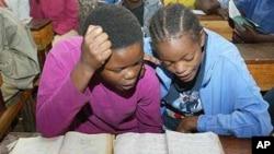 Swahili girls reading.