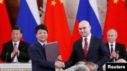 華為輪值董事長郭平2019年6月5日在中俄領導人習近平和普京的見證下代表華為與俄羅斯簽下5G合同。