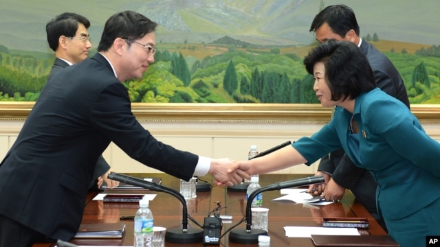 In this photo released by the South Korean Unification Ministry, South Korea's Unification Policy Officer Chun Hae-sung, left, shakes hands with the head of North Korea's delegation Kim Song Hye, right, after ending their meeting at the southern side of P