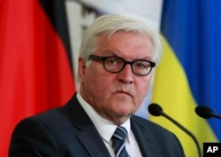 "FILE - German Foreign Minister Frank-Walter Steinmeier says the Russian travel ban on EU officials works against efforts ""to persistent and dangerous conflict in the middle of Europe."""