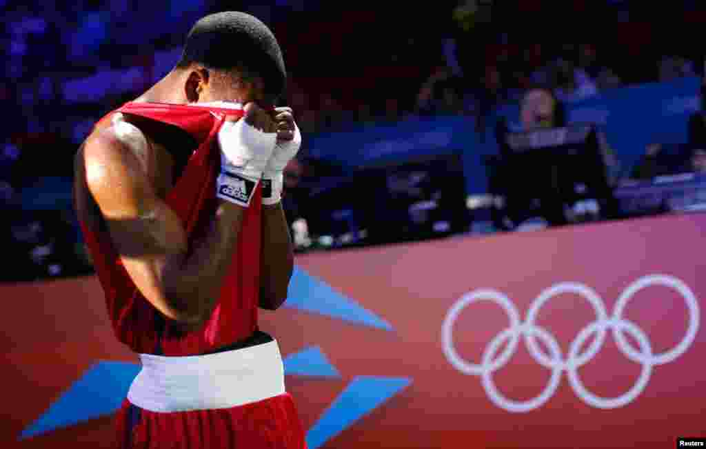Jamel Herring of the U.S. leaves the ring after losing to Kazakhstan's Daniyar Yeleussinov in the Men's Light Welter (64kg) Round of 32 boxing match.