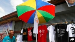 An enterprising vendor sets up his stall to sell souvenir t-shirts of leading presidential candidate Mayor Rodrigo Duterte as business resumes at his hometown in Davao city in southern Philippines, May 11, 2016.