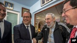 Cuba's former leader Fidel Castro, second right, shakes hands with French President Francois Hollande, while accompanied by Cuba's Foreign Minister Bruno Rodriguez, right, and an unidentified person, left, in Havana, Cuba, Monday, May 11, 2015. Hollande i