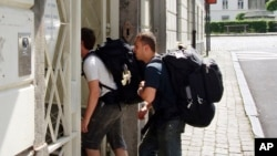 FILE - Backpackers enter a hostel in Brussels, Belgium, July 31, 2008.