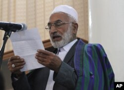 The father of Farkhunda speaks at a hearing at the Primary Court in Kabul, Afghanistan, Wednesday, May 6, 2015.