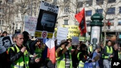 Yellow vest protesters march during a protest in Paris, Feb. 17, 2019.