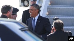 President Barack Obama greets Nevada Gov. Brian Sandoval upon his arrival on Air Force One at McCarran International Airport Monday, Aug. 24, 2015, in Las Vegas.