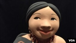 A closer look at one of Kathleen Wall's ceramic dolls. (J.Taboh/VOA)