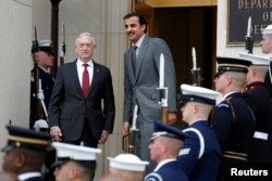 U.S. Secretary of Defense Jim Mattis stands with Qatari Emir Sheikh Tamim bin Hamad al-Thani during an Enhanced Honor Cordon at the Pentagon in Arlington, Virginia, near Washington, April 9, 2018.