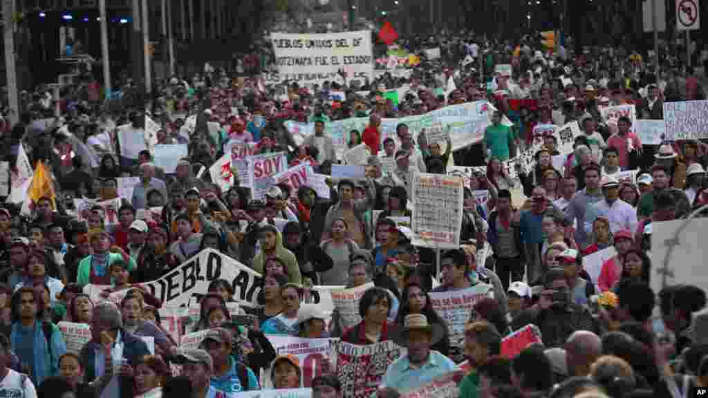 Tens of thousands of demonstrators march in protest for the disappearance of 43 students in the state of Guerrero, in Mexico City, Nov. 5, 2014.
