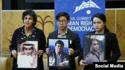 Anh Dennis Châu (giữa), con trai ông Châu Văn Khảm và tấm hình của cha, tại Geneva Summit 18/2. Gia đình anh đã không được tiếp xúc hay nói chuyện với ông Khảm, hiện đang bị chịu án tù ở Việt Nam, trong nhiều tháng qua. (Photo Facebook Geneva Summit 2020)