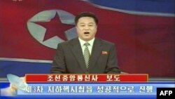North Korean TV on Feb. 12, 2013 shows an announcer reading a statement on the country's nuclear test. (North Korean TV)