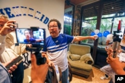 FILE - Nicaraguan journalist Miguel Mora speaks to the press after his release from prison, at his home in Managua, Nicaragua, June 11, 2019.