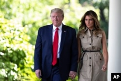 President Donald Trump and first lady Melania Trump arrive for a White House National Day of Prayer Service in the Rose Garden of the White House, May 7, 2020, in Washington.