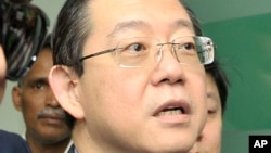 FILE - In this June 29, 2016, file photo, Lim Guan Eng, chief minister of northern Penang state, is arrested by the Malaysian Anti-Corruption Commission (MACC) at his office in Penang island, Malaysia.