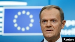 FILE - European Council President Donald Tusk addresses a news conference during a European Union leaders summit in Brussels, Belgium, Dec. 15, 2017.