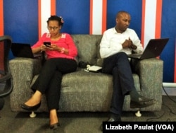 Dr. John Mark Bwanika and his colleague engage Twitter users, answering questions on cancer prevention and screening.