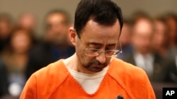 FILE - Dr. Larry Nassar, 54, appears in court for a plea hearing in Lansing, Michigan, Nov. 22, 2017. Nassar has pleaded guilty to molesting female gymnasts.