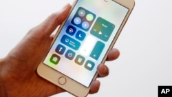 In this Sept. 15, 2017, photo, the iOS 11 control center is displayed on the iPhone 8 Plus in New York. (AP Photo/Mark Lennihan)