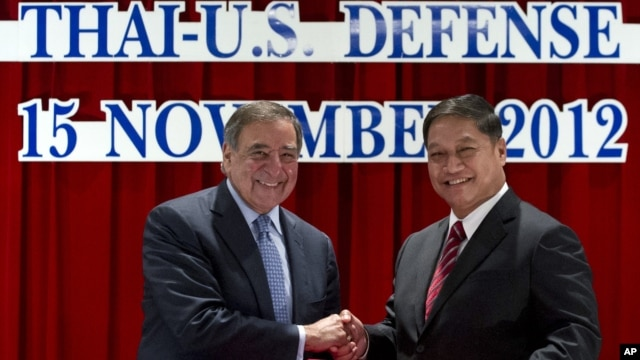 U.S. Secretary of Defense Leon Panetta, left, and his Thai counterpart Sukampol Suwannathat shake hands after signing the 2012 Joint Vision Statement for the Thai - US Defense Alliance, Bangkok, November 15, 2012.