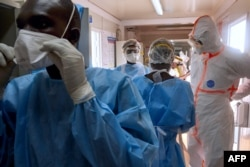 Medical staff of International Medical Corps put on Personal Protective Equipment at the isolation ward of Ministry of Health Infectious Disease Unit in Juba, South Sudan, on April 24, 2020.