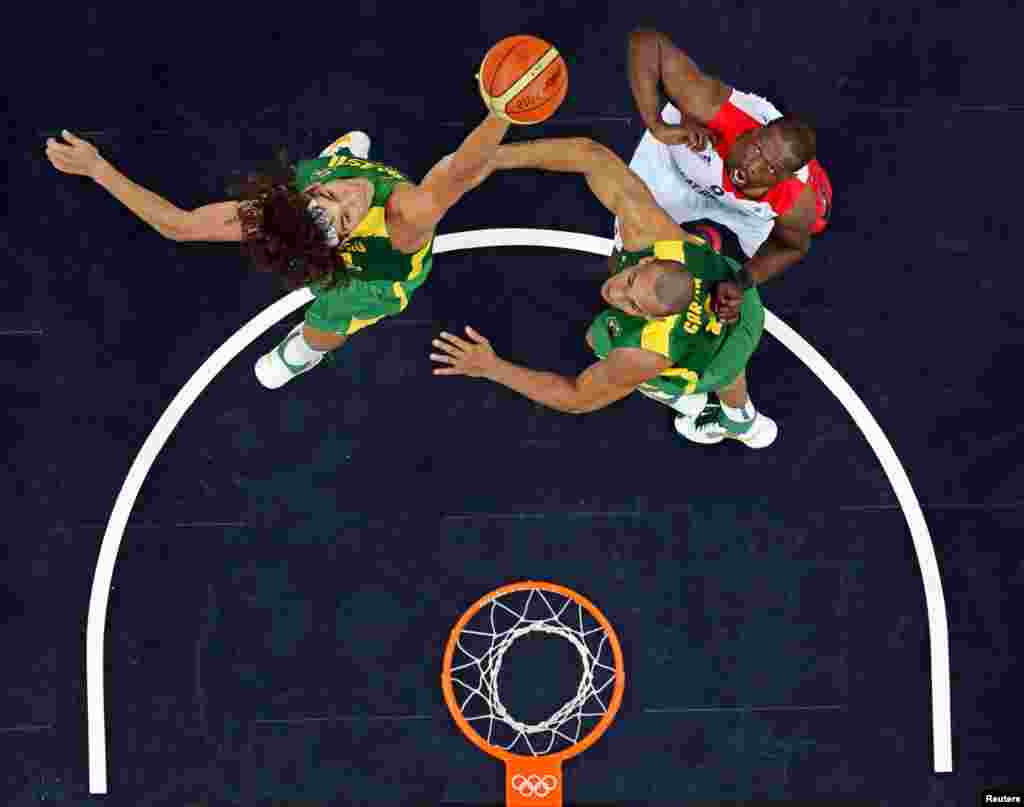 Brazil's Anderson Varejao blocks the shot of Great Britain's Luol Deng during their men's preliminary round Group B basketball match.
