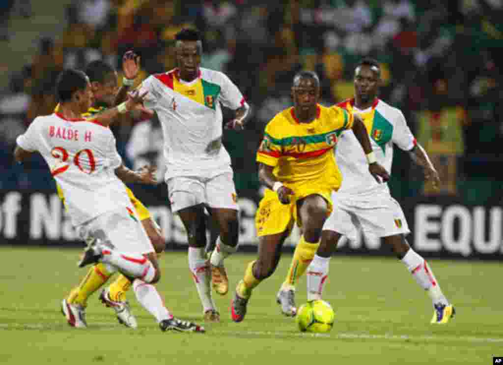 Mali's Samba Diakite challenges Guinea's Dioulde Bah, Feindouno and Balde during their African Nations Cup Group D soccer match at Franceville Stadium