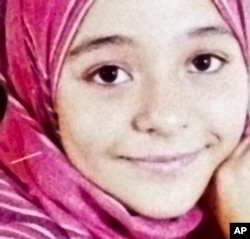 FILE - Soheir al-Batea died in 2013, the victim of a botched female genital mutilation, a widespread practice performed on more than 90 percent of girls and women in Egypt.