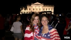 Soccer fans Laura Neff of California (left) and Kayli Westling of Wyoming celebrate the U.S. women's national team World Cup final victory with the American Outlaws outside the White House, July 5.