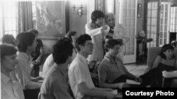Seiji Ozawa talks with Leonard Bernstein during a lecture for Tanglewood students in this undated file photo. (Walter H. Scott)