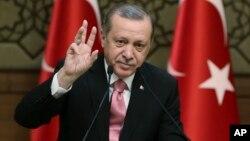 Turkey's President Recep Tayyip Erdogan addresses local administrators, in Ankara, Feb. 8, 2017.