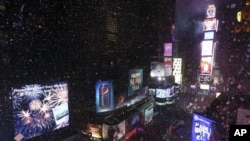 A festive place to count down to the New Year - Times Square in New York City, where confetti flies over celebrating crowds,after the clock strikes midnight.