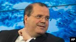 FILE - Brazilian central bank President Alexandre Tombini, pictured at the World Economic Forum in Davos, Switzerland, in 2014, has not ruled out selling part of the country's $371 billion foreign reserves to calm the exchange rate market.