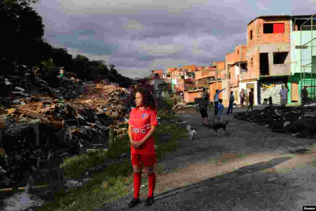 Vitoria Batista Oliveira, 14, waits for a boy to catch a missing ball during a training session of soccer in Jardim Peri Alto slum, on the outskirts of Sao Paulo, Brazil, June 5, 2019.