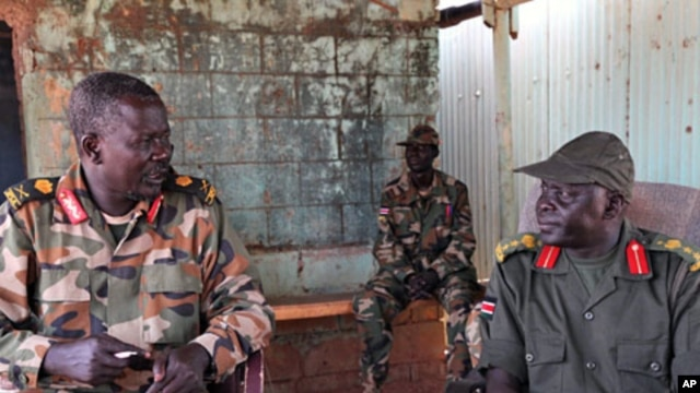 An April 14, 2012 photo shows Sudan Peoples Liberation Army (SPLA) troops at their position in the Unity Oil Field near the front lines at Heglig.