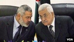 Prezidan otorite palestinyen an Mahmoud Abbas adwat ak and Premye minis Palestinyen an Ismail Haniyeh pou pati Hamas la agoch (foto achiv)