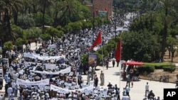 A rally organized by the 20th February, the Moroccan Arab Spring movement in Marrakech, Morocco, Sunday May 8, 2011, to protest against the terrorism following a bomb explosion in Marrakech.(AP)
