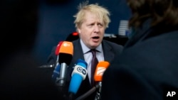 British Foreign Secretary Boris Johnson speaks with the media as he arrives for a meeting of EU foreign ministers at the Europa building in Brussels, March 19, 2018.
