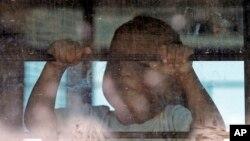 Dijete imigranata u autobusu na granici u Teksasu