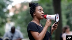University of North Carolina student Gabrielle Johnson speaks to a crowd gathered at a Confederate monument protest on campus in Chapel Hill, N.C., Aug. 31, 2017.