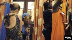 Models wearing East African designer clothing prepare for a runway show in Kampala, Uganda, May 17, 2014. (Hilary Heuler / VOA News)