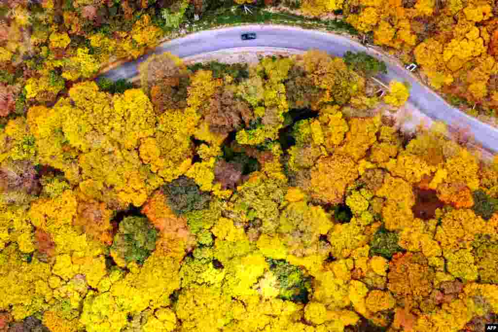 This image taken from above shows a car moving along a road near the village of Martkopi,  Georgia.