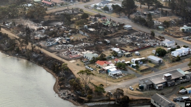 An aerial photo shows a view of Dunalley after a wildfire destroyed around 80 buildings in and around the small town, east of the Tasmanian capital of Hobart, Australia, January 5, 2013.